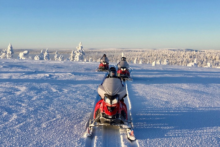 Snowmobiles + ice fishing on a wilderness lake